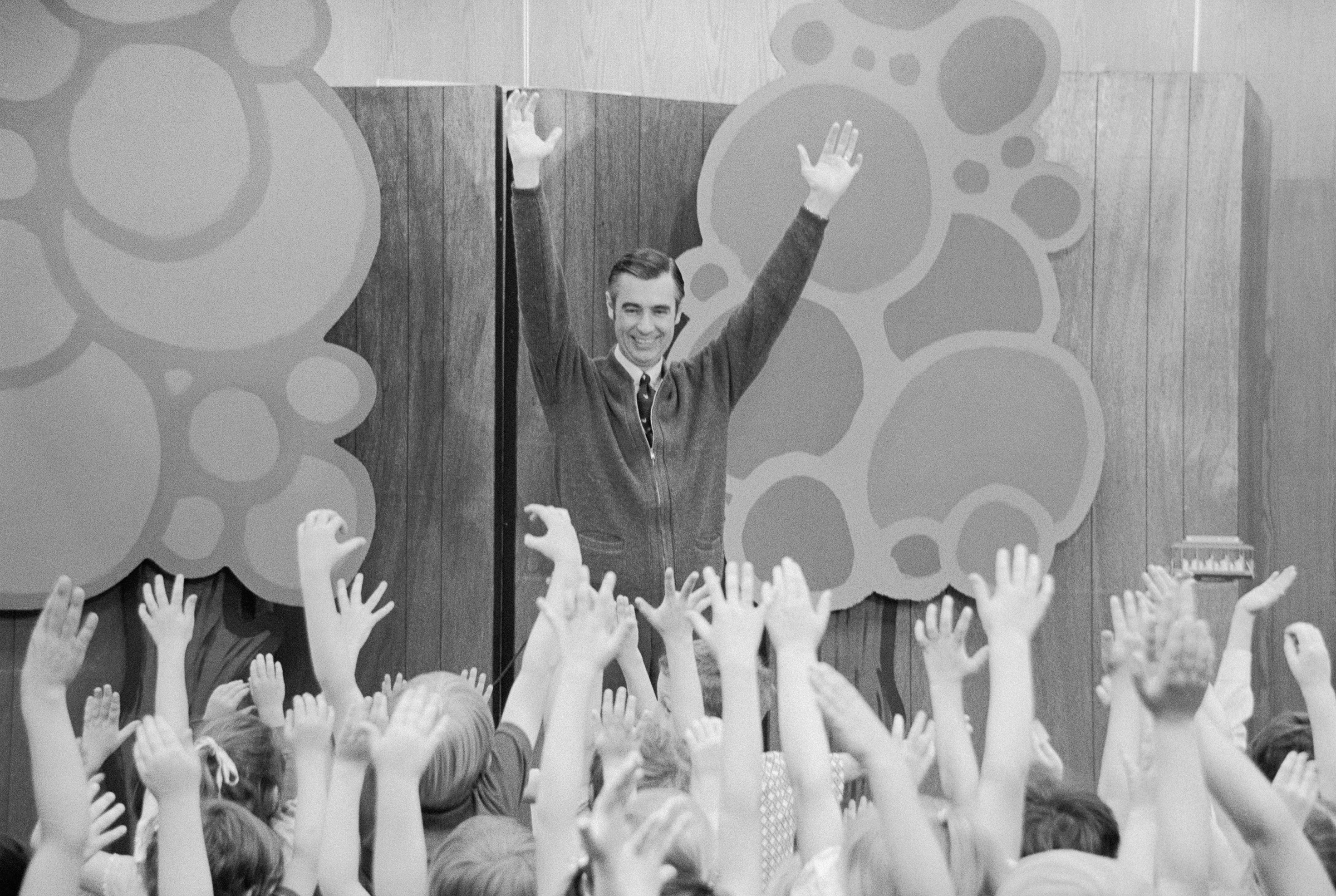 Fred Rogers of  Mister Rogers' Neighborhood  entertains children during a Mister Rogers' Day celebration. Several thousand children from the surrounding states attended the event held at the University of South Dakota on May 26, 1973
