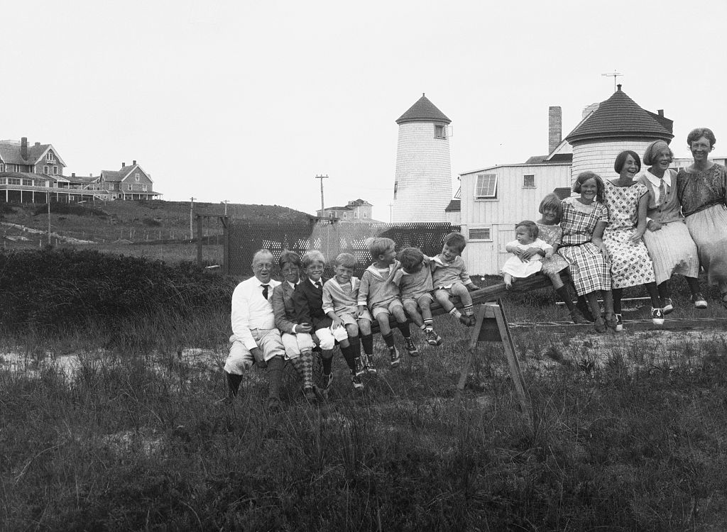 The Gilbreth family, including mother Lillian Gilbreth, a pioneering scientist, sits atop a see-saw in Nantucket, Mass., in 1923.