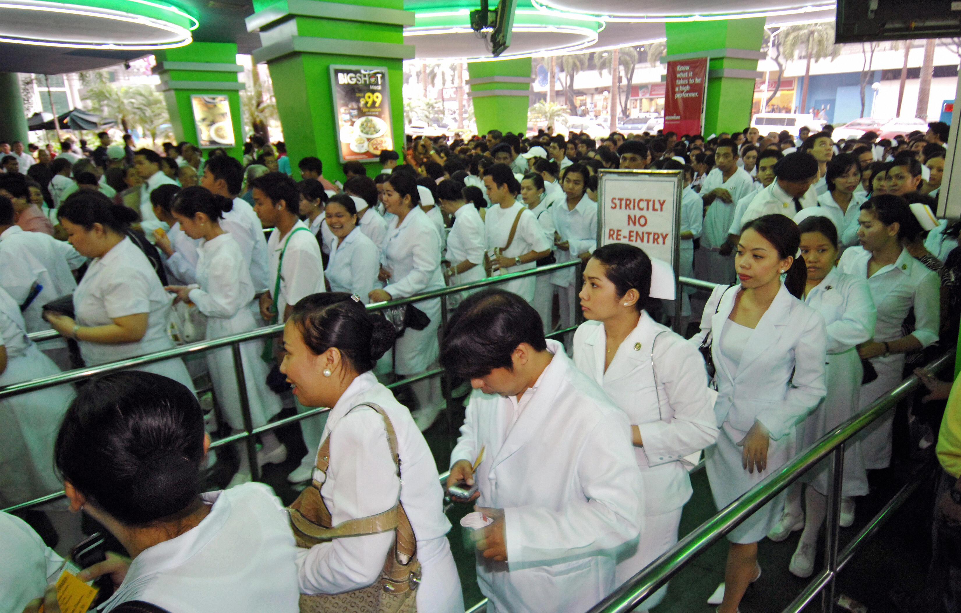 Hundreds of nurses arrive at the Araneta coliseum in Manila, 02 October 2007 to attend official oath taking ceremonies after passing the June 2007 government licensure examination, where 31,275 successful examinees from the more than 64,000 passed the tests conducted nationwide.