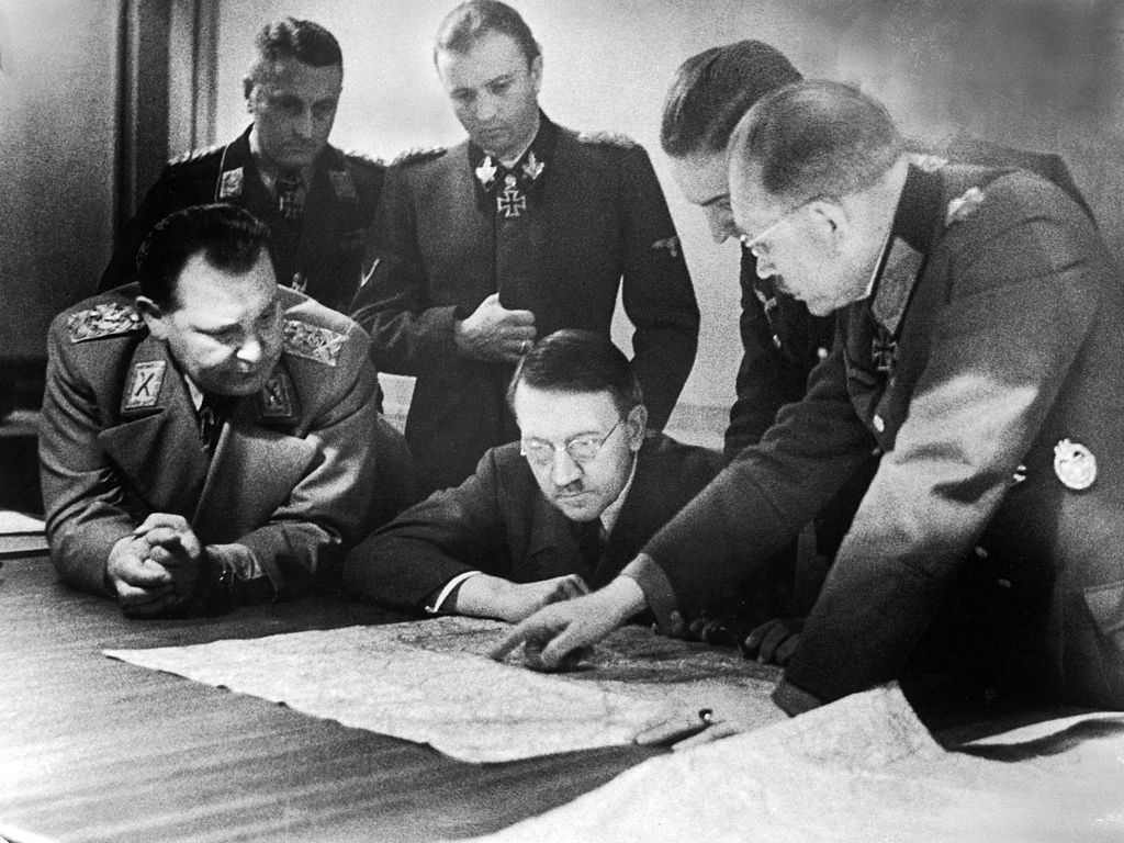 Adolf Hitler (center, in glasses) and members of his General Staff review plans for 'Operation Bodenplatte' (also known as 'the Great Blow'), an airstrike in support of the Ardennes offensive, late 1944.
