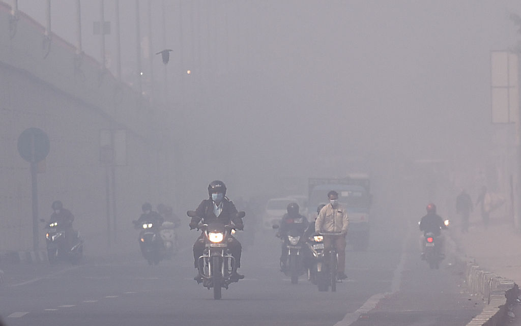 Commuters out on a smoggy day at NH-9 near Mayur Vihar on Feb. 8, 2021 in New Delhi, India.