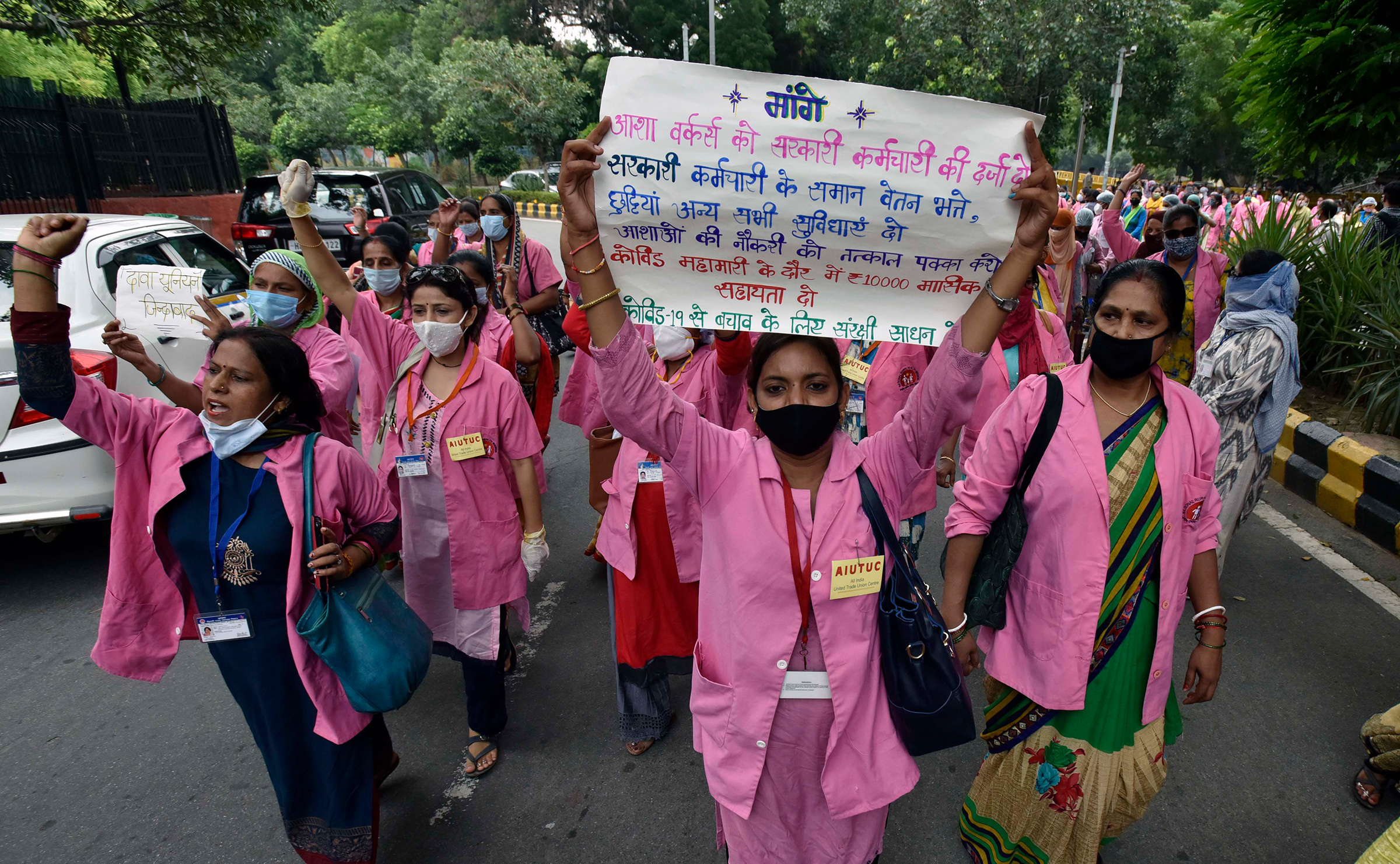 Accredited Social Health Activist (ASHA) workers protest against alleged negligence of their workforce by the government on August 9, 2020 in New Delhi. During the protest, ASHA workers demanded payment for their work during the COVID-19 pandemic, saying they have not been paid for the past few months.