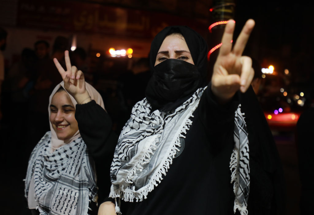 Palestinians celebrate in the streets following a ceasefire, in Gaza City May 21, 2021.