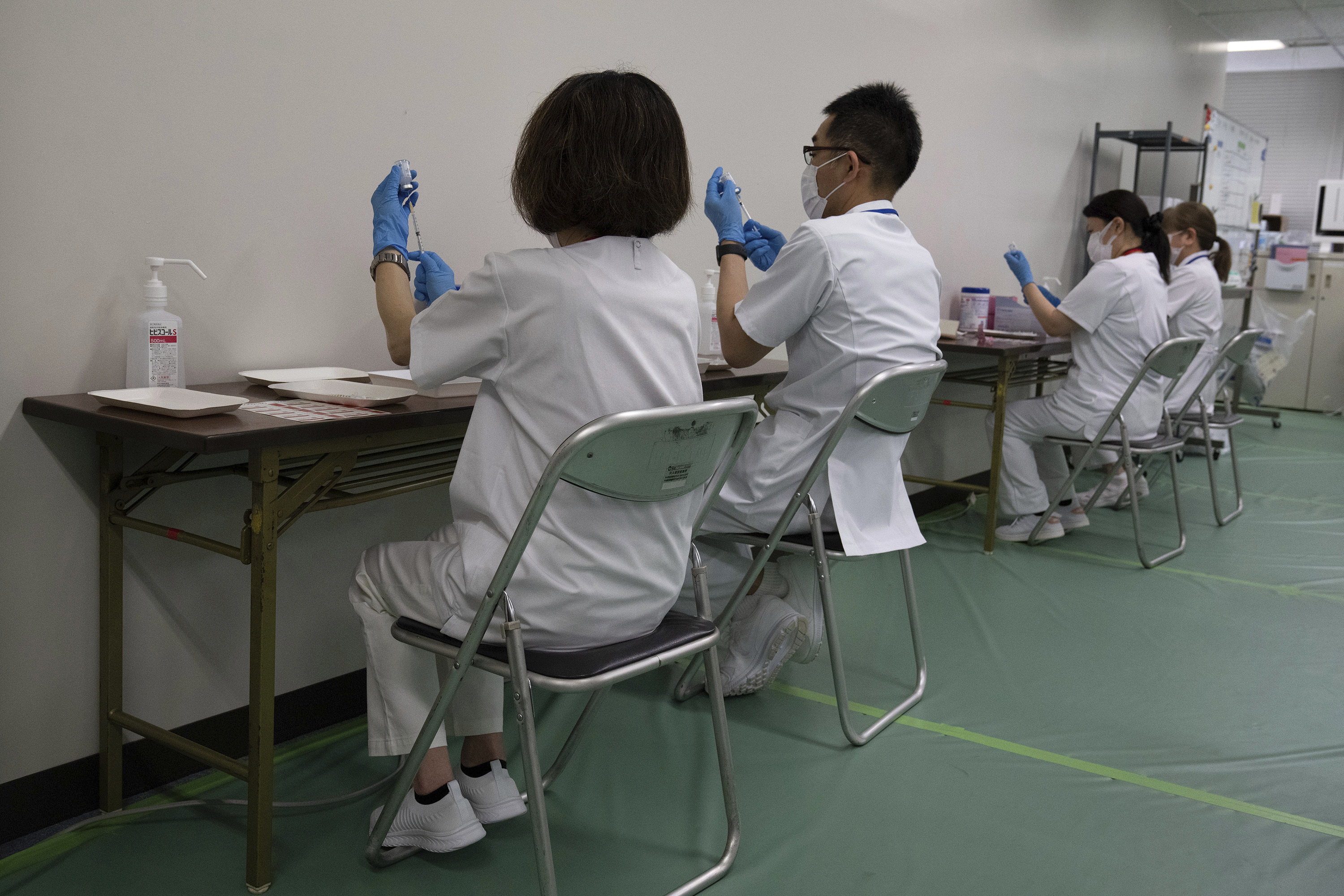 Medical staff prepare the Moderna coronavirus vaccine for use at the newly-opened mass vaccination center in Tokyo Monay, May 24, 2021.