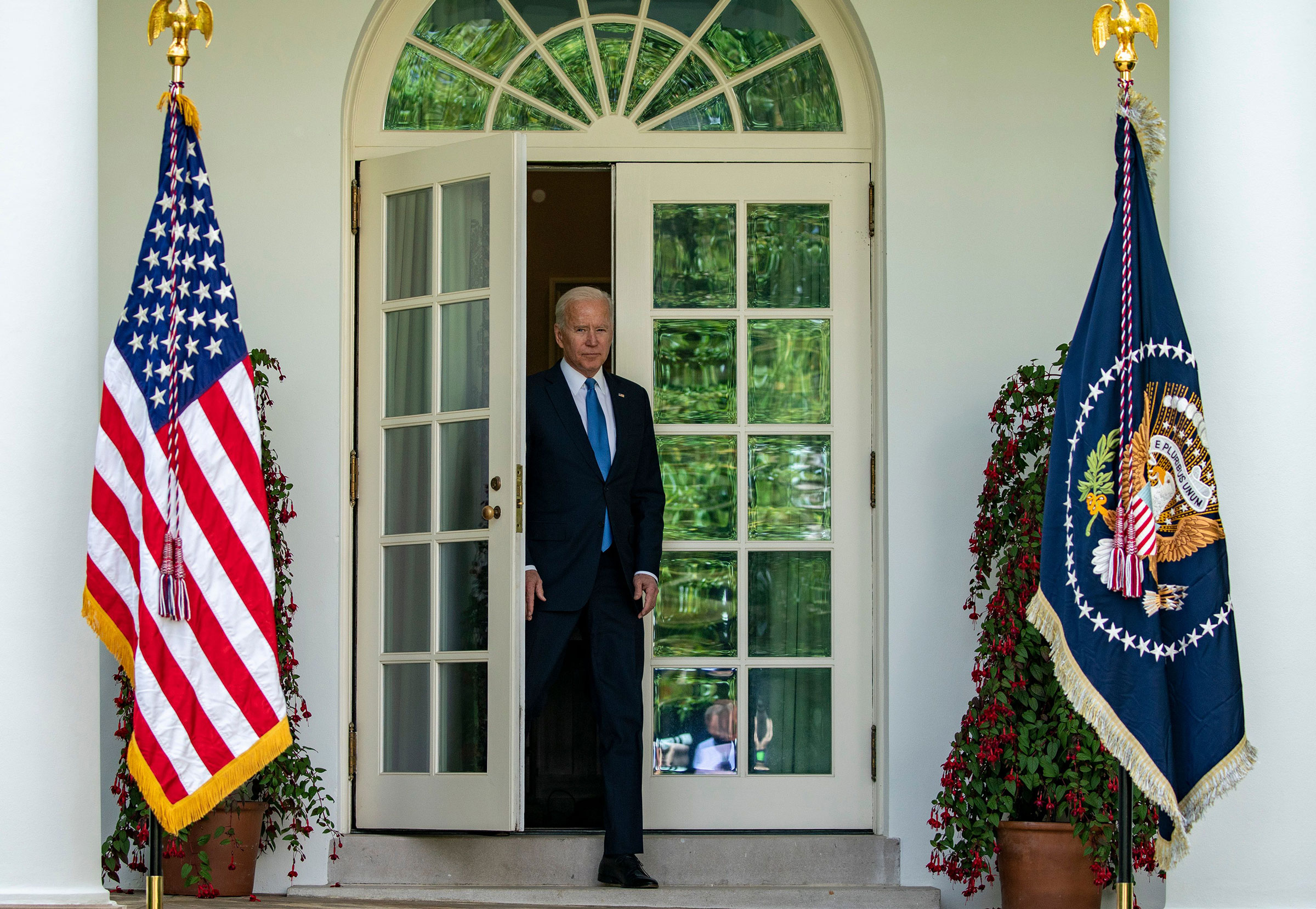 President Joe Biden enters the rose garden to give remarks May 13, 2021.
