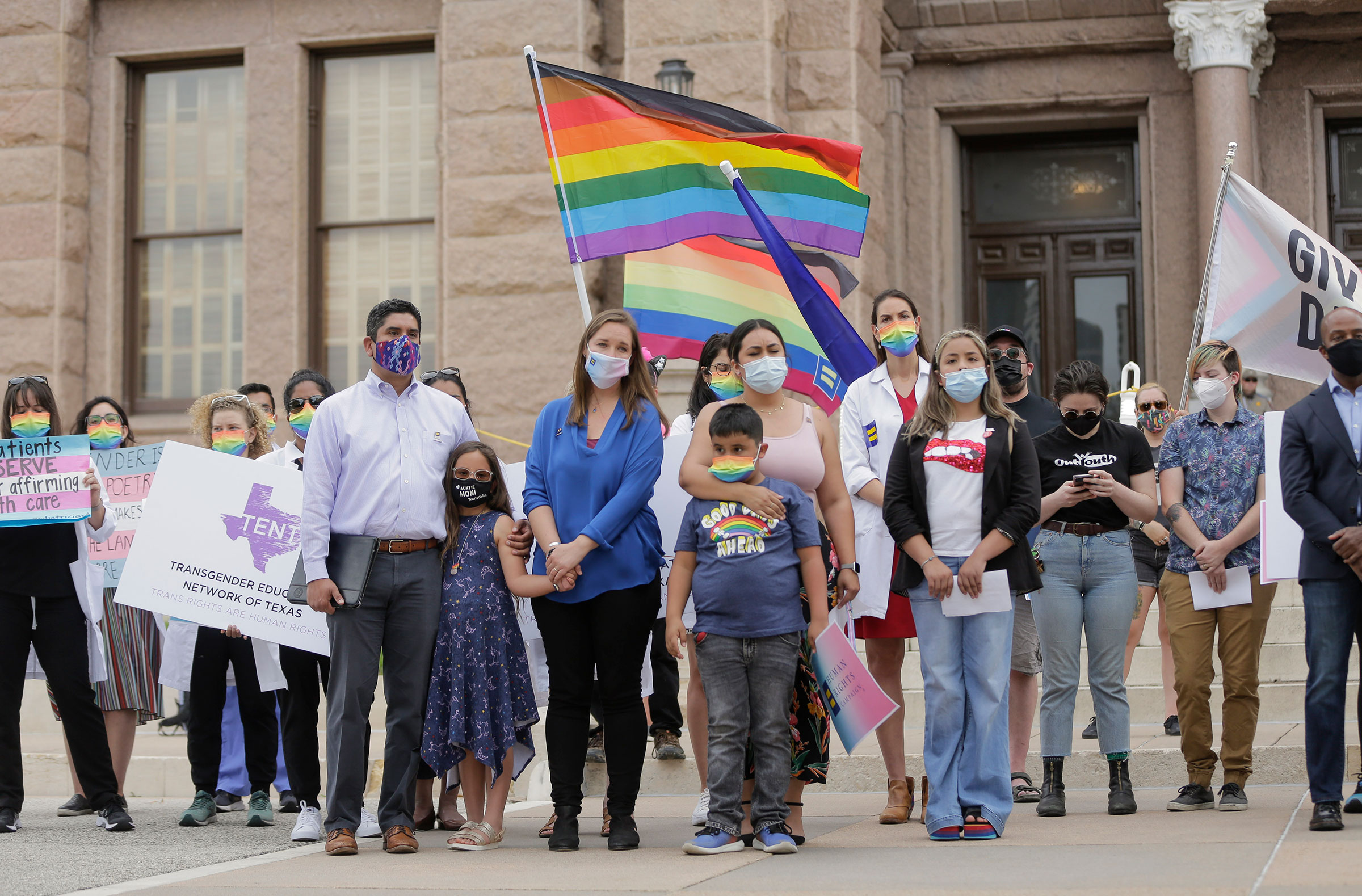 LGBTQ advocates including representatives from Equality Texas, the Transgender Education Network of Texas, Texas Freedom Network, ACLU of Texas, Lambda Legal, medical and health care professionals, and parents of transgender children rally at the Texas State Capitol on May 4, 2021 in Austin to stop proposed medical care ban legislation that would criminalize gender-affirming care.
