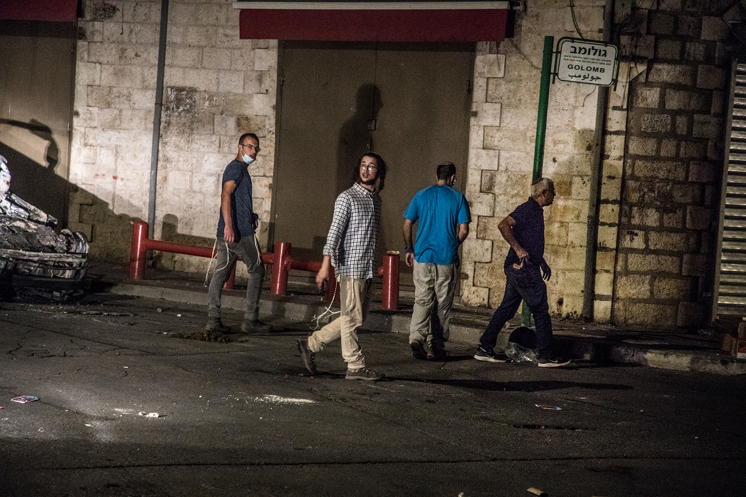 Young Jewish men from a group comprising settlers and extreme right-wing activists, mostly armed, try to approach the downtown mosque in the mixed city of Lod, Israel, on May 12.
