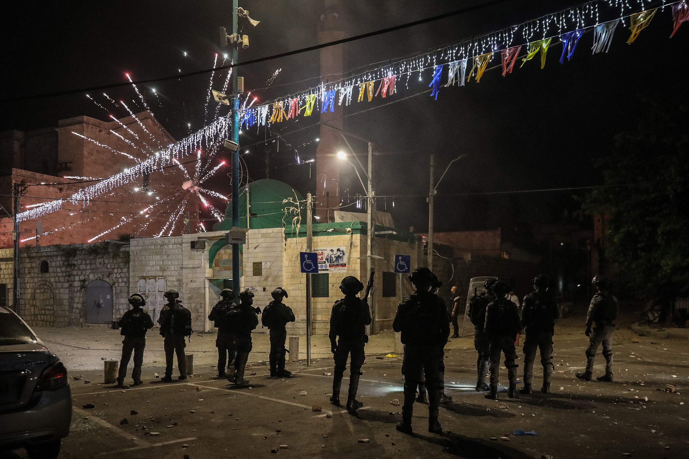Fireworks are released towards Israeli soldiers during clashes amid a night-time curfew in Lod on May 12.