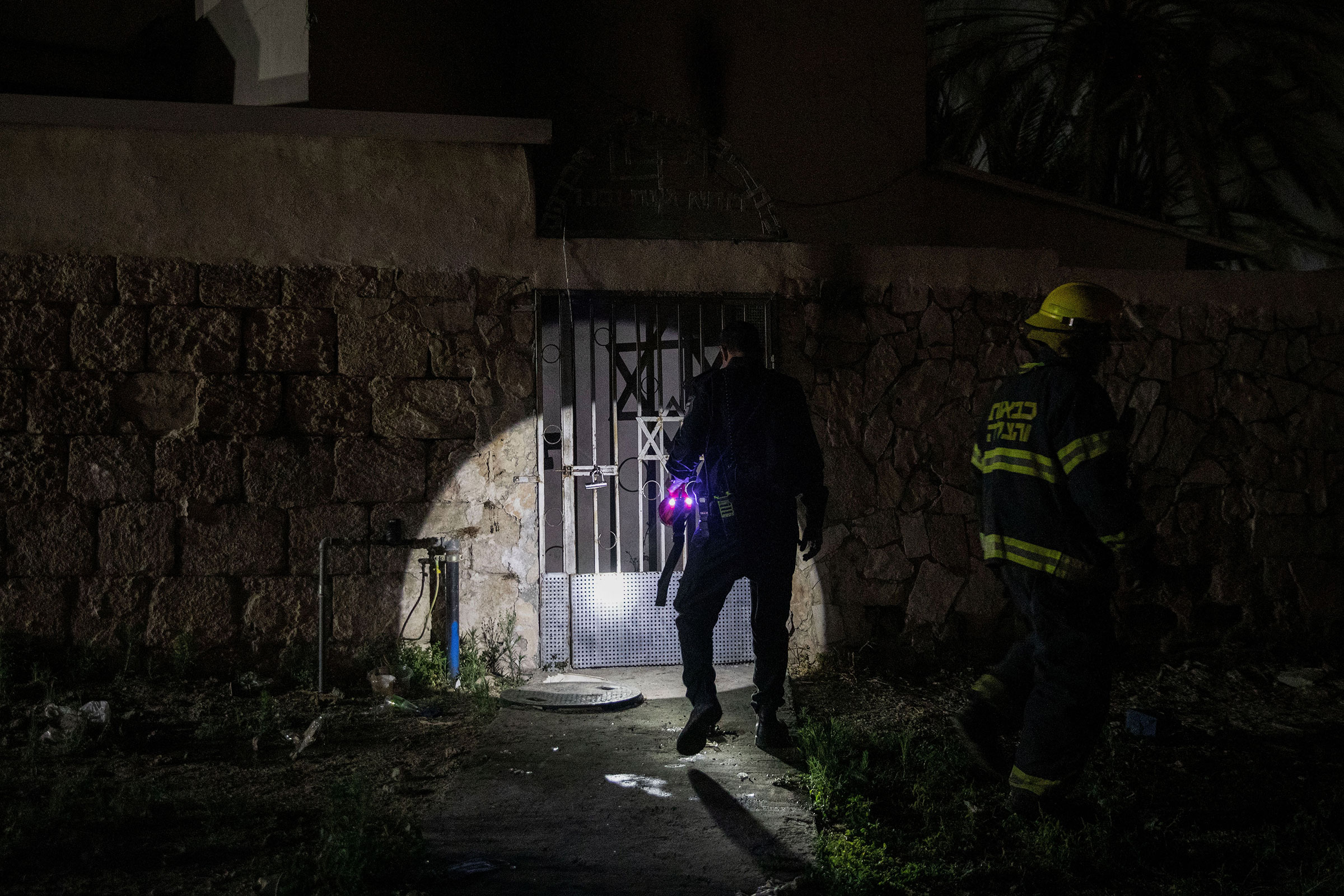 Firefighters inspect a synagogue that was set on fire during violent clashes in the mixed Arab-Jewish city of Lod, Israel, on May14, 2021.