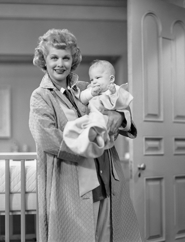 Lucille Ball as Lucy Ricardo, holding Richard Lee Simmons as Little Ricky Jr.  Image dated March 1, 1953.