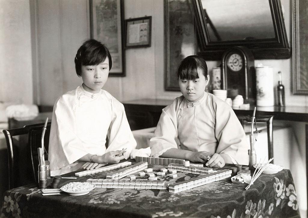 Two Chinese girls playing mah-jongg, circa 1920s