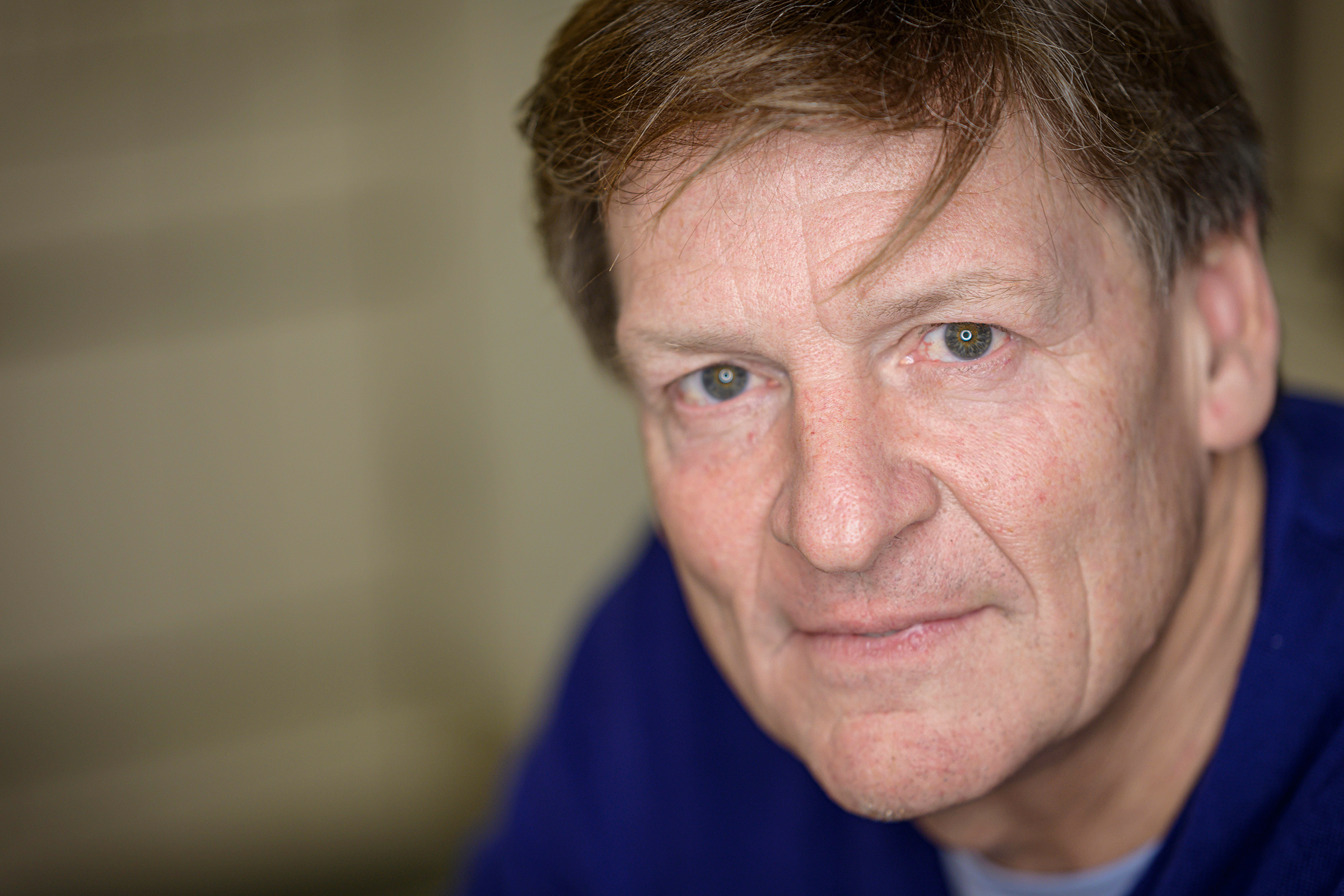 Michael Lewis poses for a portrait in 2019.