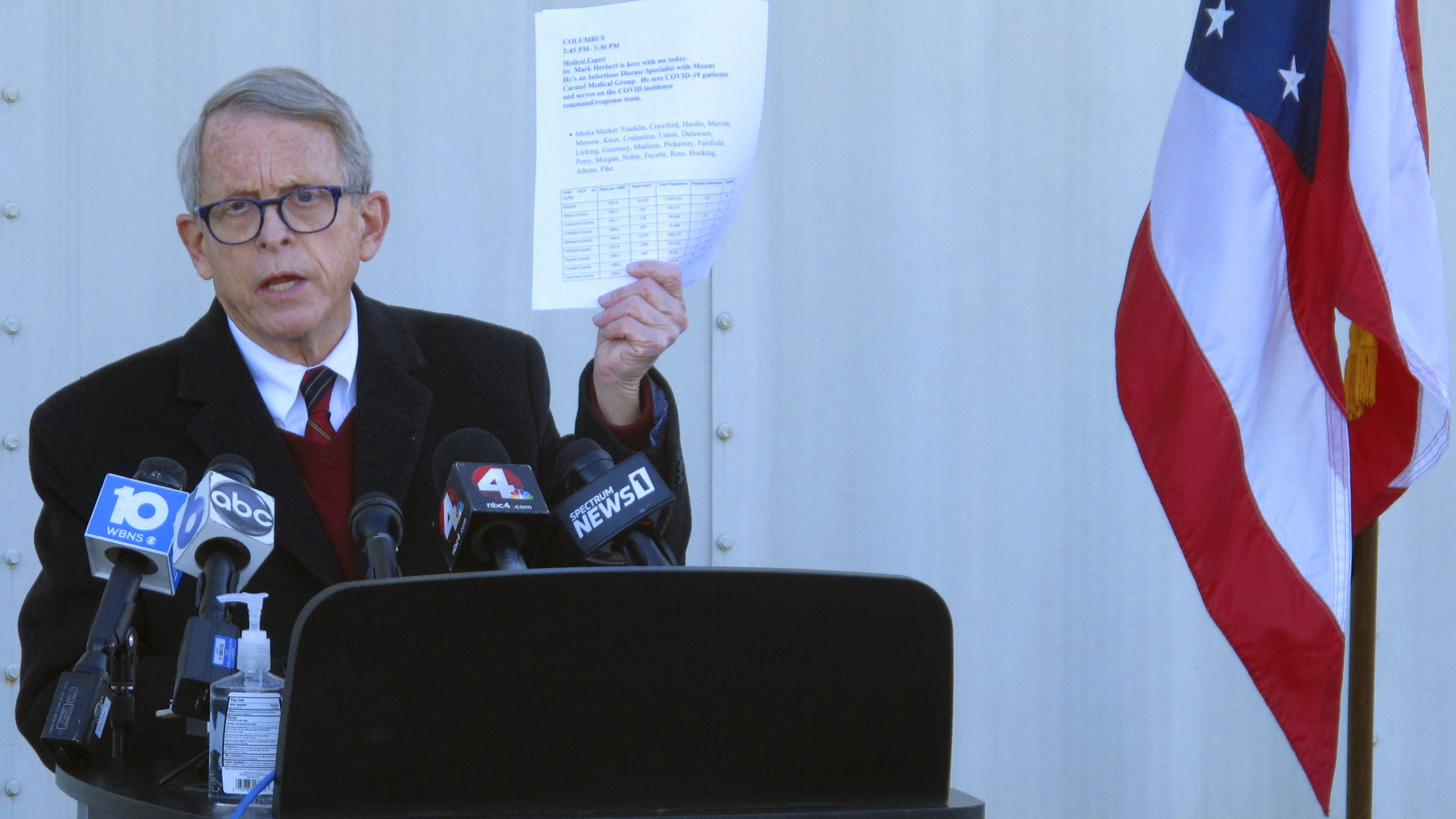 In this Nov. 18, 2020 file photo, Republican Ohio Gov. Mike DeWine discusses the most recent data on Ohio's soaring coronavirus cases during a news briefing at John Glenn International Airport in Columbus, Ohio.  DeWine is ready to address Ohioans in his fourth primetime speech about the state's progress against the coronavirus pandemic.  DeWine planned his address for late Wednesday, May 12, 2021.