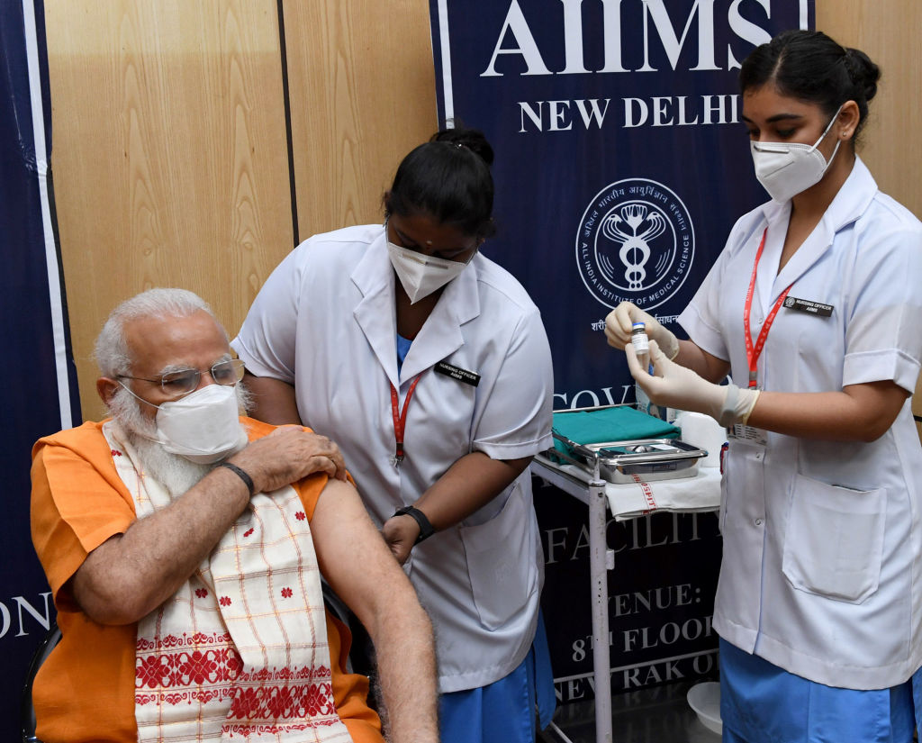 Indian Prime Minister Narendra Modi receives the second dose of the Covaxin COVID-19 vaccine, at AIIMS Hospital, New Delhi on April 08, 2021.