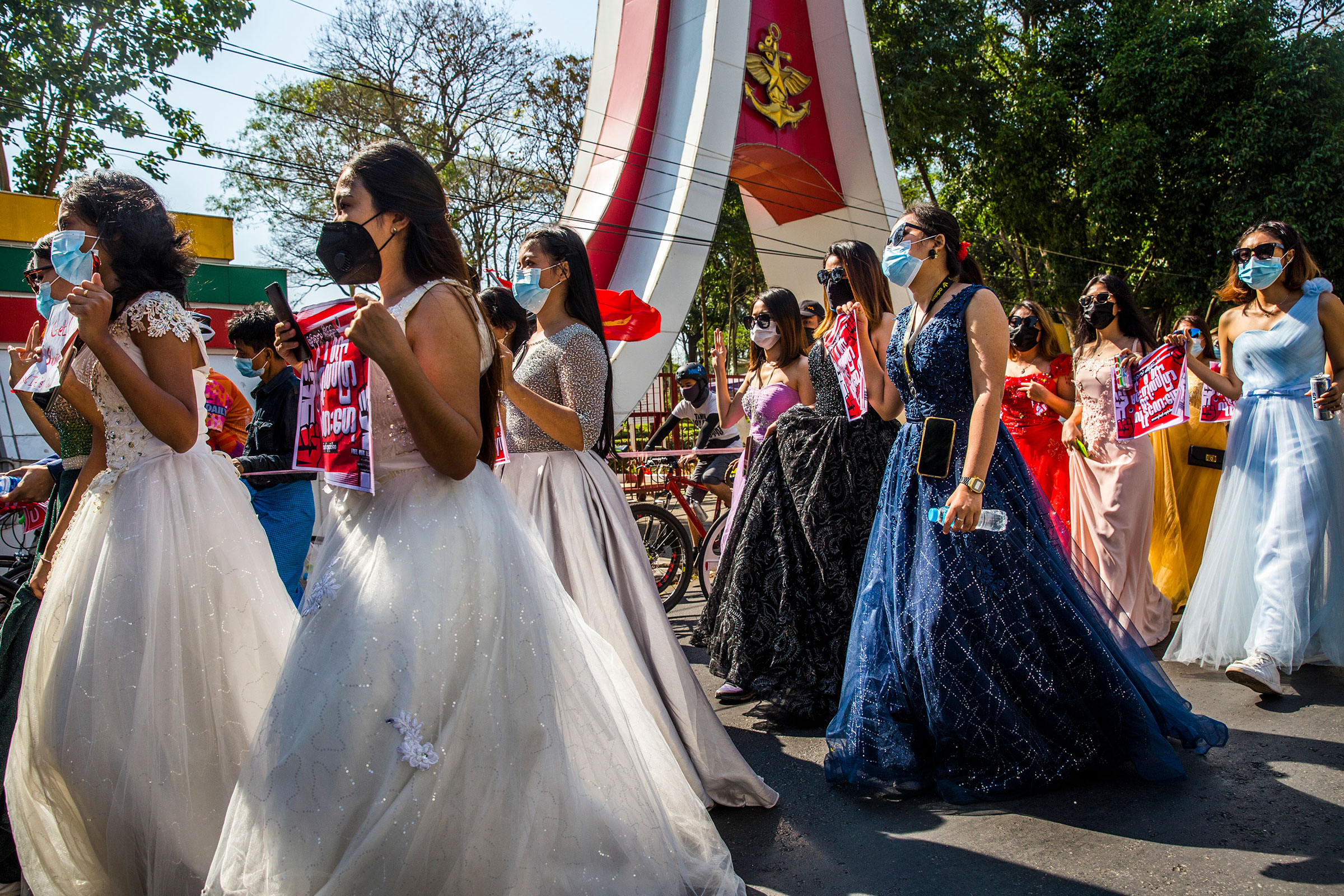 A group of women wearing formal gowns march in Yangon, Myanmar, on Feb. 10, 2021, to protest against the military coup.
