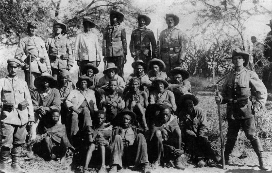 German soldiers pose with captured Nama - Hottentots, circa 1905.