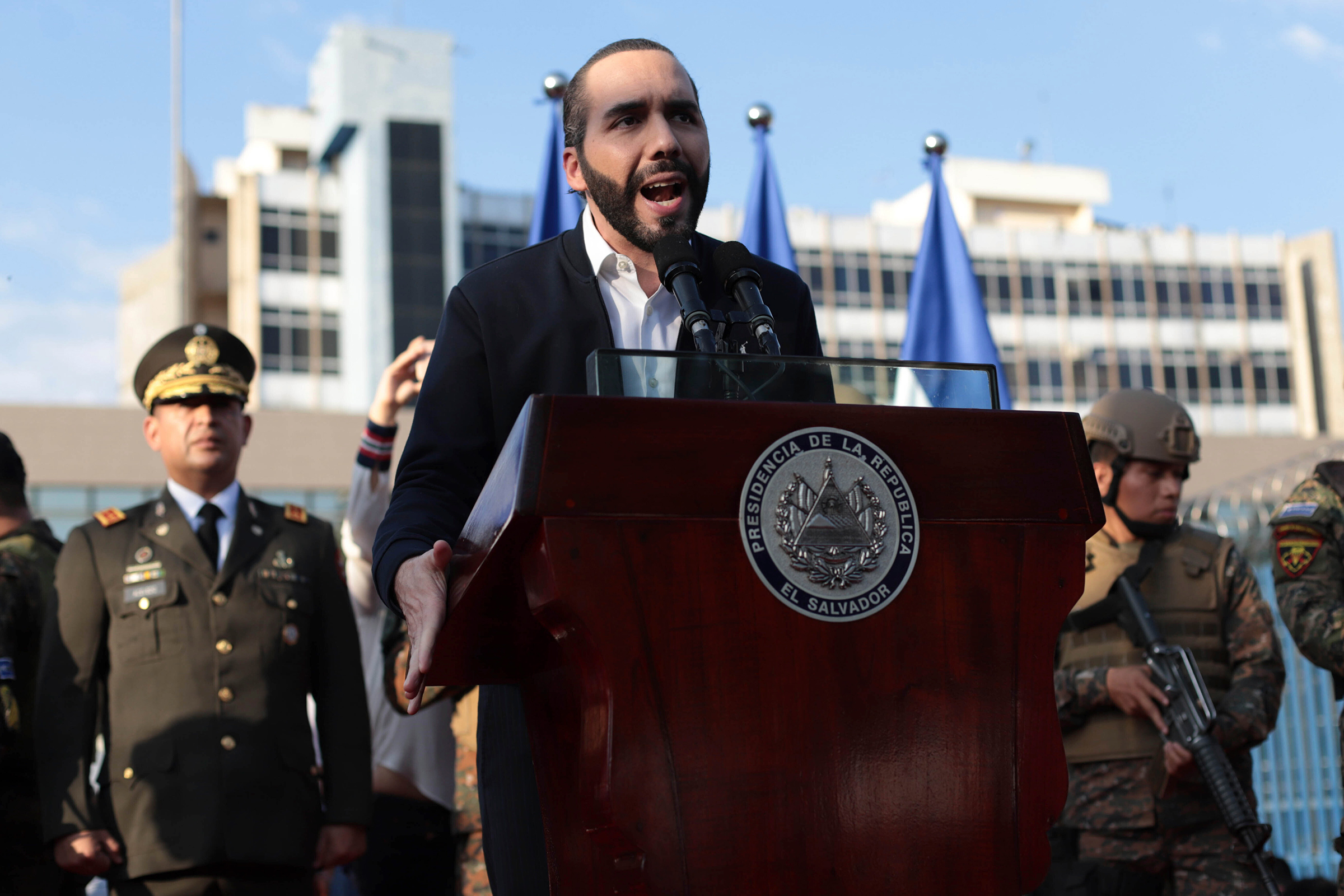 El Salvador's President Nayib Bukele, accompanied by members of the armed forces, speaks to his supporters outside Congress in San Salvador on Feb. 9. Bukele's party has swept all three main opposition parties during 2021's midterm elections, giving him a mandate to change the way politics are run in the central American country.