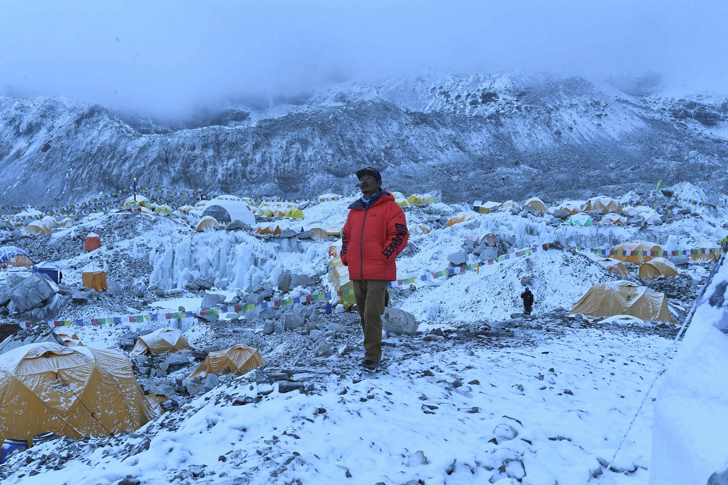 Mountaineer and expedition manager Tashi Lakpa Sherpa poses for a picture on May 1 at Everest base camp. A coronavirus outbreak on Mount Everest has seen dozens of people evacuated by helicopter from the foot of the world's highest peak, derailing Nepal's plans for a record climbing season.