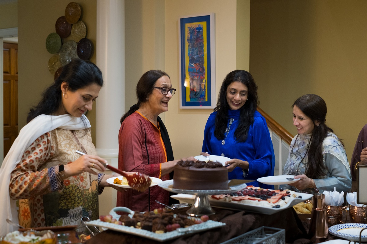 From left, Afsheen Rizvi, 45, Najma Shamsi, 75, Sana Haque, 45, and Atifa Malik, 44, share a laugh as they break fast together.