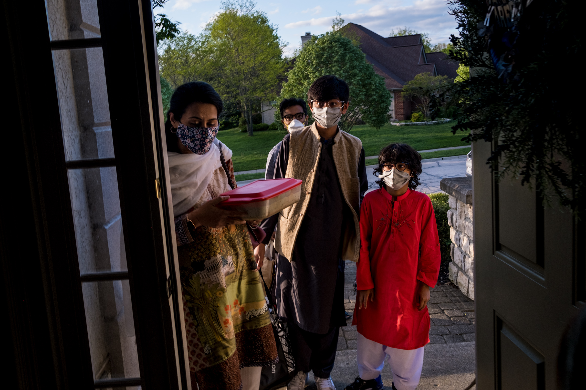 From left, Afsheen Rizvi, 45, her husband Tariq Sayed Rizvi, 45, behind, and their two sons Mahad, 12, and Arhem, 8, arrive at potluck dinner at their friend's home in Dublin, Ohio on May 5.