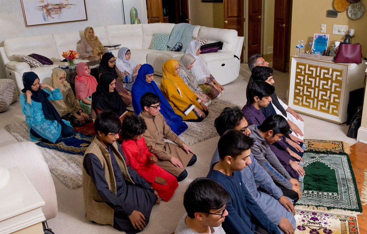 Five Muslim families perform a late-night prayer.