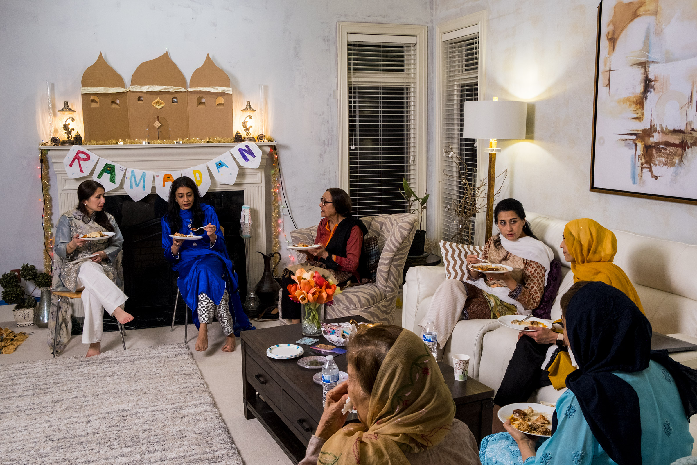 Muslim women break their fast with iftar and chat.