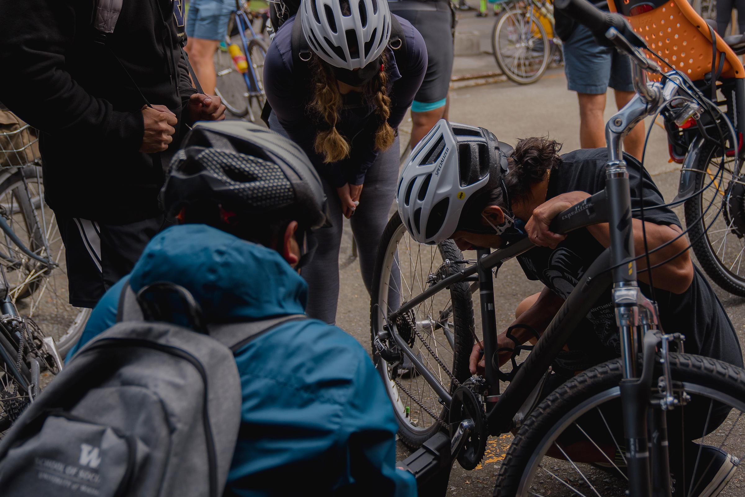 Members of the NorthStar Cycling Club perform bike maintenance before their weekly ride.