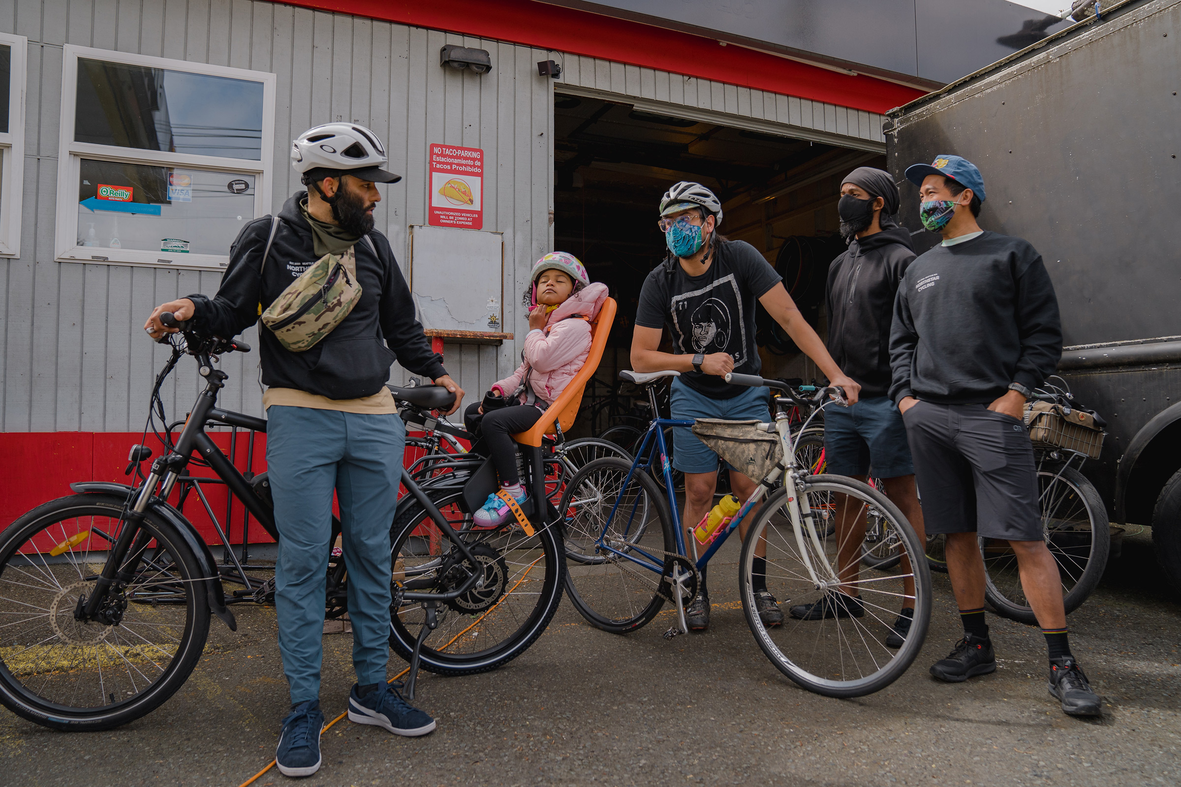 Edwin Lindo, left, co-founder of the NorthStar Cycling Club, discusses potential routes for the club's weekly ride around Seattle.