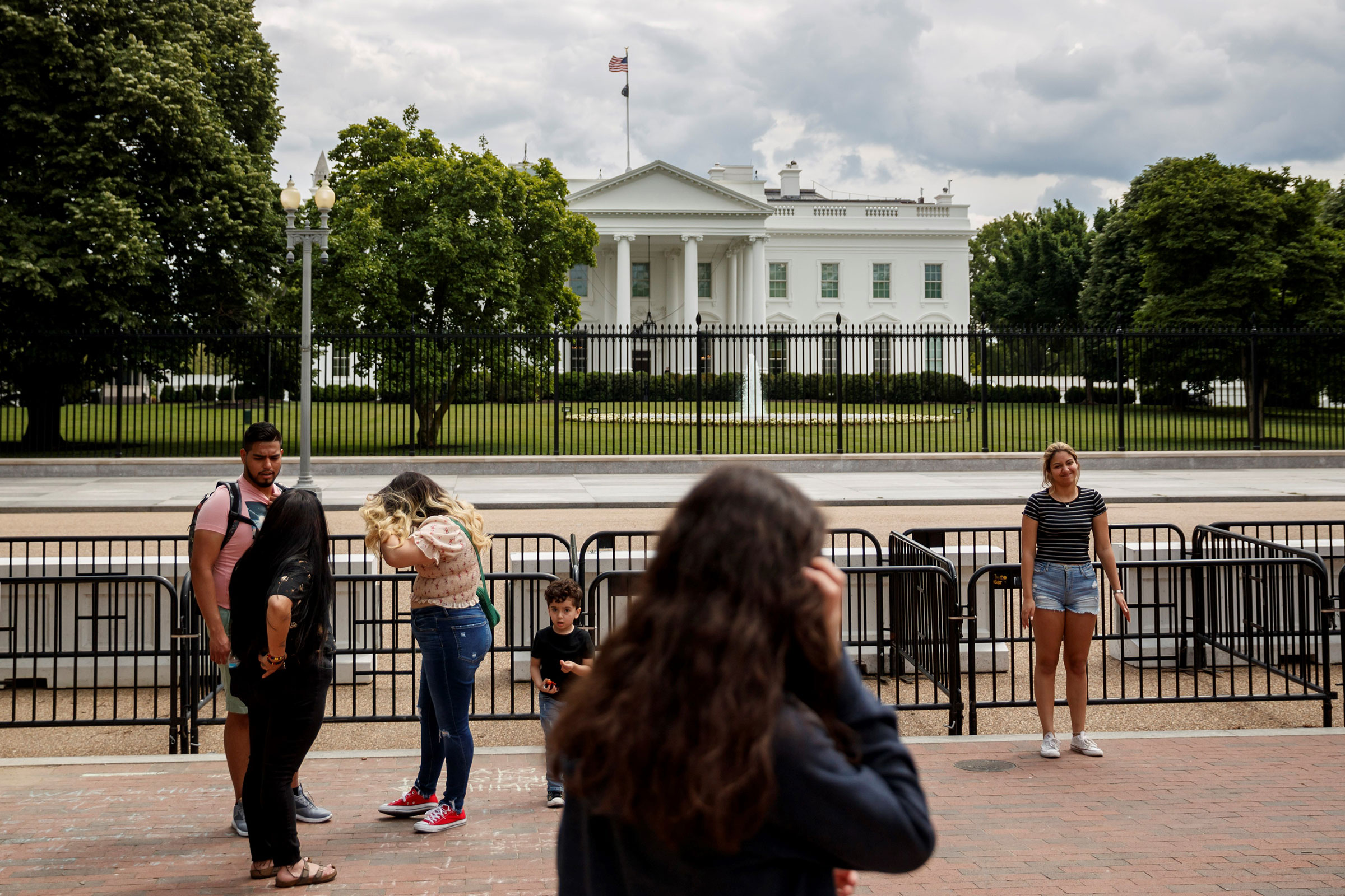 People are seen near the White House in Washington, on May 17, 2021.