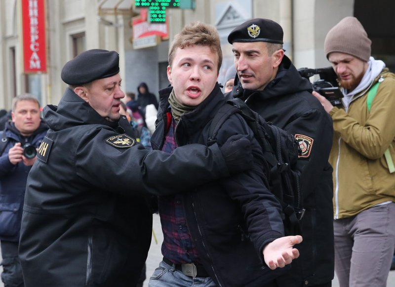 In March 2017, police officers detain journalist Roman Protasevich while attempting to cover a rally in Minsk.
