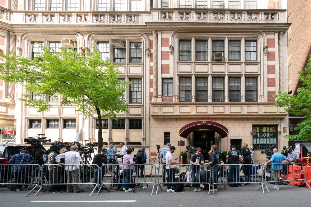 After the raid, members of the media gathered outside the apartment building of the home and office of Rudy Giuliani, the former New York City mayor and President Donald Trump's former personal lawyer, on April 28, 2021.