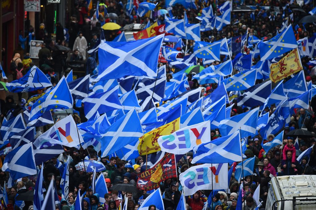 Protesters with Scottish Saltire flags attend a march calling for Scottish independence in Glasgow on January 11, 2020.
