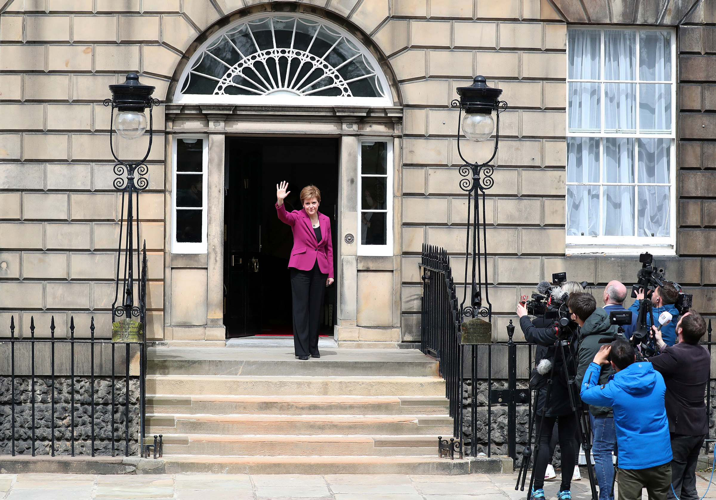 "Scotland's First Minister and Scottish National Party leader Nicola Sturgeon poses for photographers at Bute House in Edinburgh on May 9. Sturgeon said the election results proved a second independence vote for Scotland was ""the will of the country."