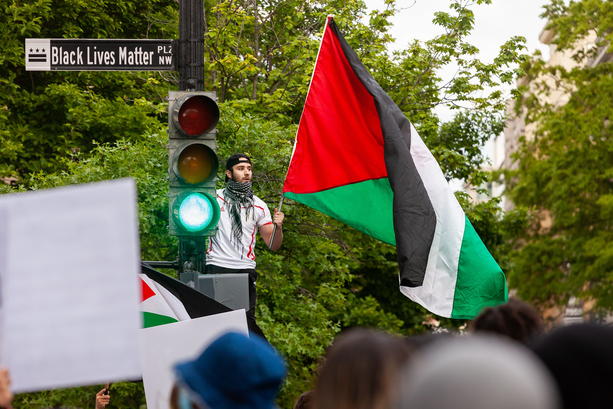 A man waves a Palestinian flag near the White House during a protest on May 11, 2021. Democratic Congresswoman Rashida Tlaib, who is of Palestinian descent, compared the Palestinian struggle to how Black Americans have risen up against police brutality in the past year.