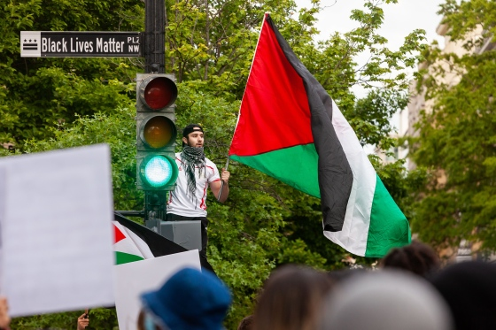 A man waves a Palestinian flag near the White House during a protest on May 11, 2021.