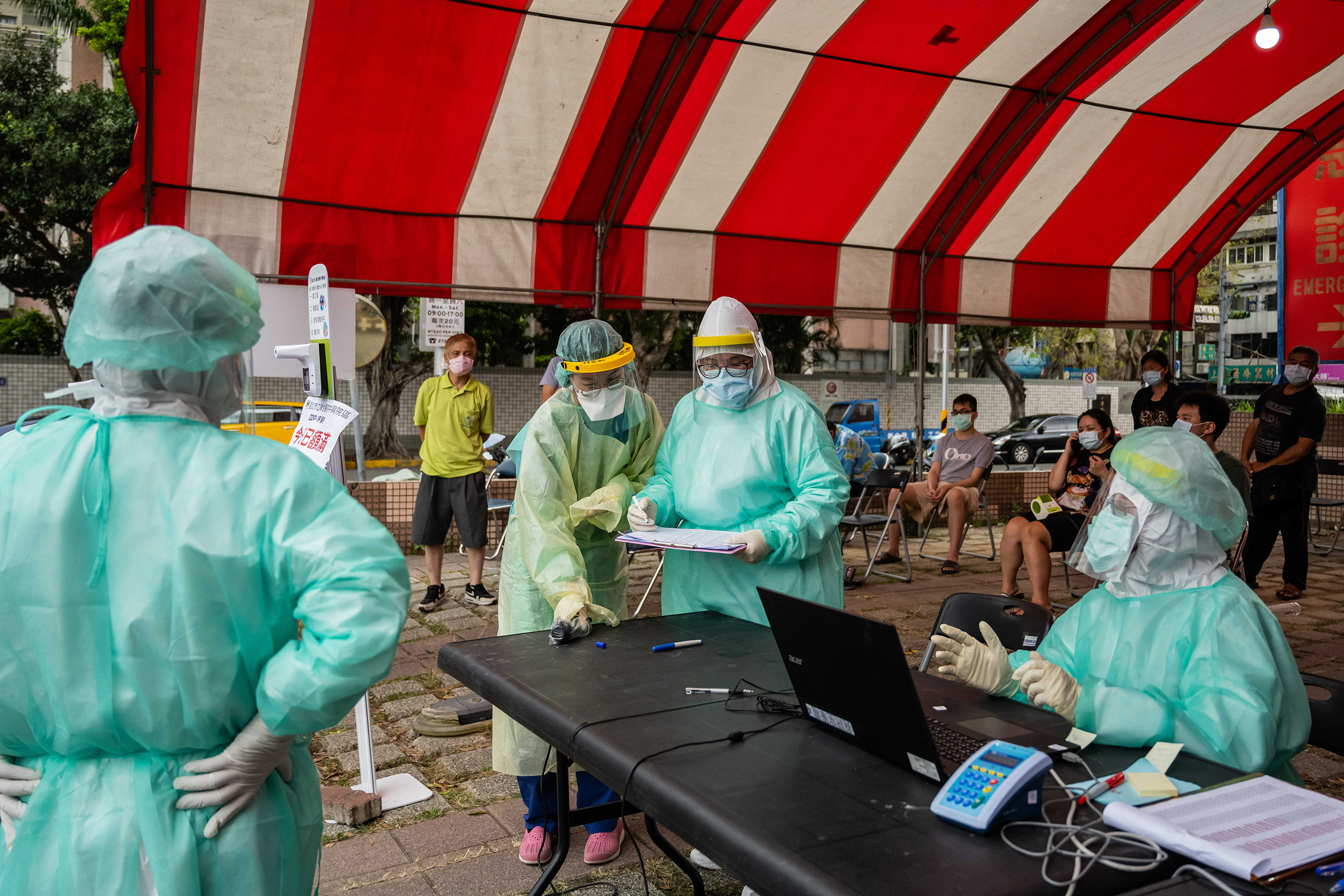 Health care workers at a temporary COVID-19 rapid testing site in Taipei on May 17, 2021.