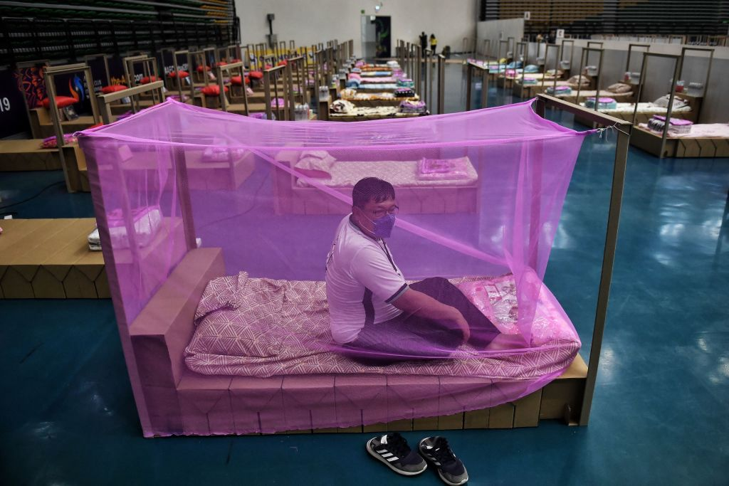 A Bangkok Metropolitan Administration worker tests a bed for incoming COVID-19 coronavirus patients at a new field hospital in a sports stadium on the outskirts of Bangkok on April 18, 2021.