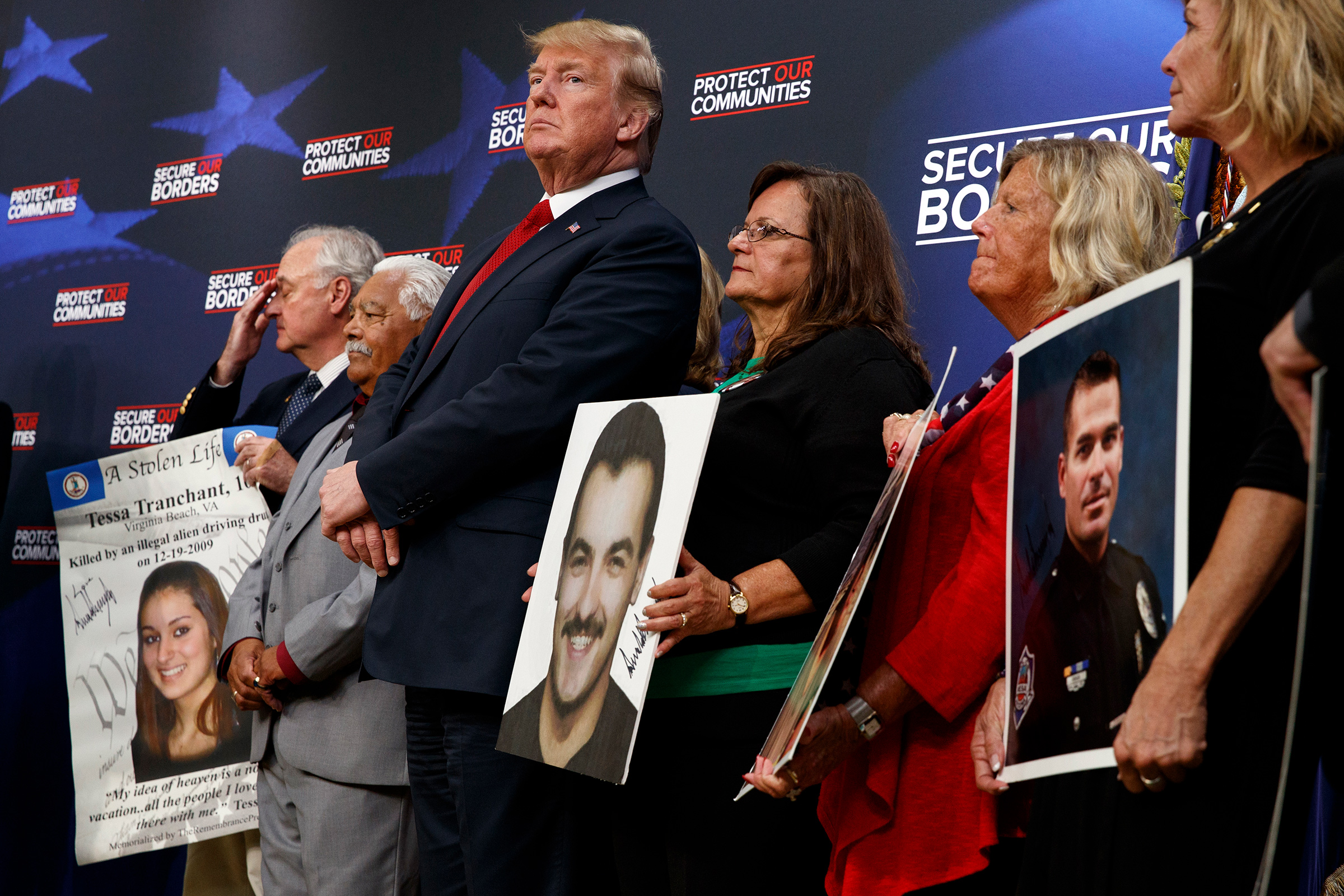 Former President Donald Trump stands alongside  angel families  at the White House complex on June 22, 2018.
