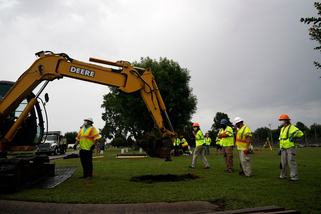 Archaeologists and observers watch during a test excavation of the potential 1921 Tulsa Race Massacre Graves at Oaklawn Cemetery in Tulsa, Okla., on July 13, 2020.