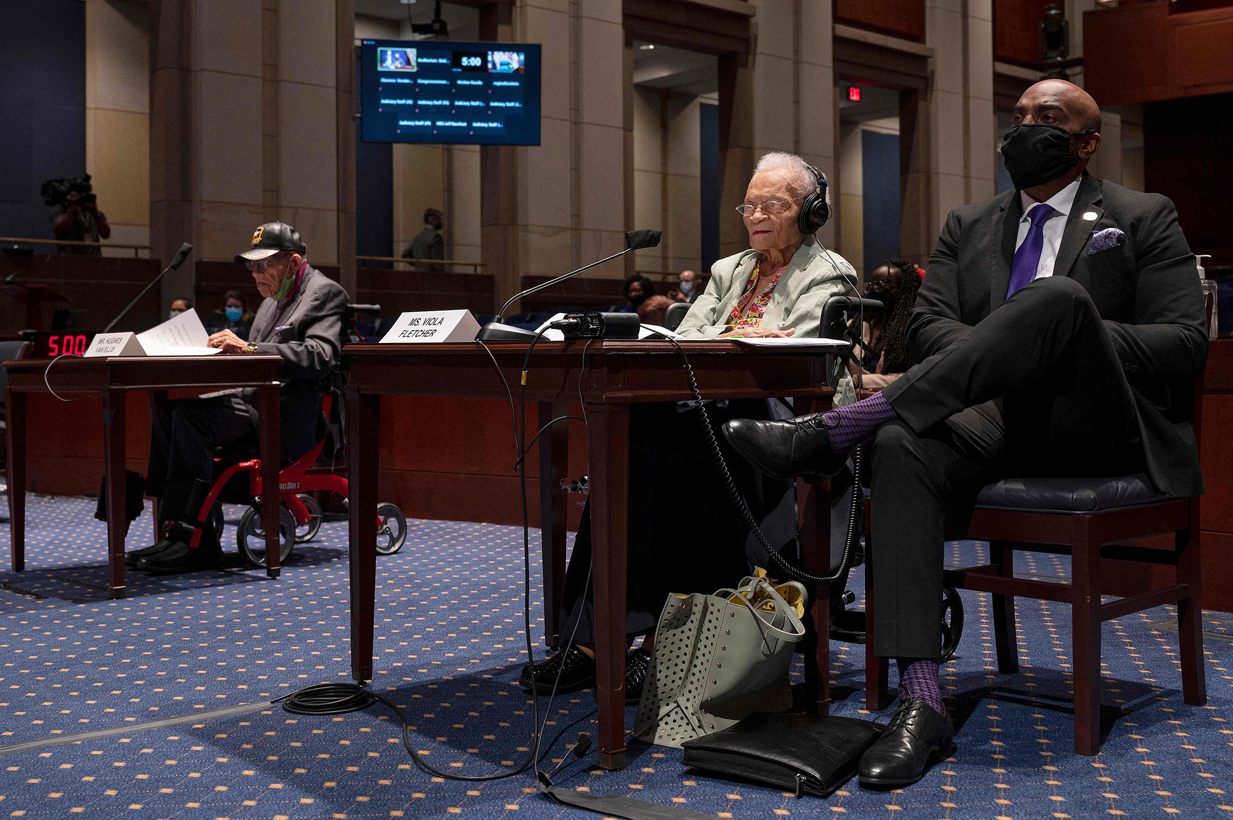 Hughes Van Ellis (left), a Tulsa Race Massacre survivor, and Viola Fletcher, the oldest living survivor, testify before the Civil Rights and Civil Liberties Subcommittee hearing on  Continuing Injustice: The Centennial of the Tulsa-Greenwood Race Massacre  on Capitol Hill in Washington, D.C., on May 19, 2021.