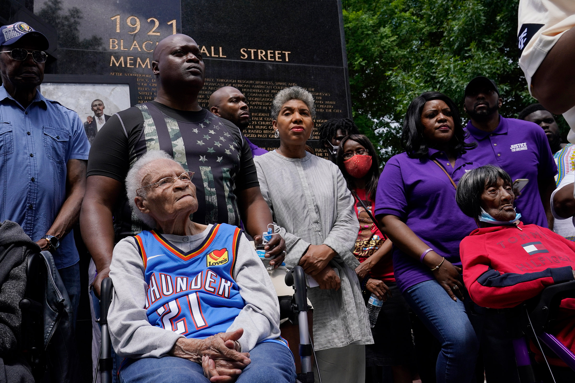 Tulsa Race Massacre survivors Viola Fletcher, left, and Lessie Benningfield Randle, right, listen during a rally marking centennial commemorations in Tulsa, Okla., on May 28, 2021.