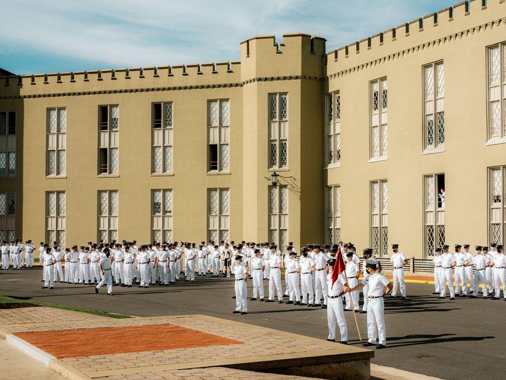 Cadets gather outside the barracks, near the area where Stonewall Jackson's statue once stood.