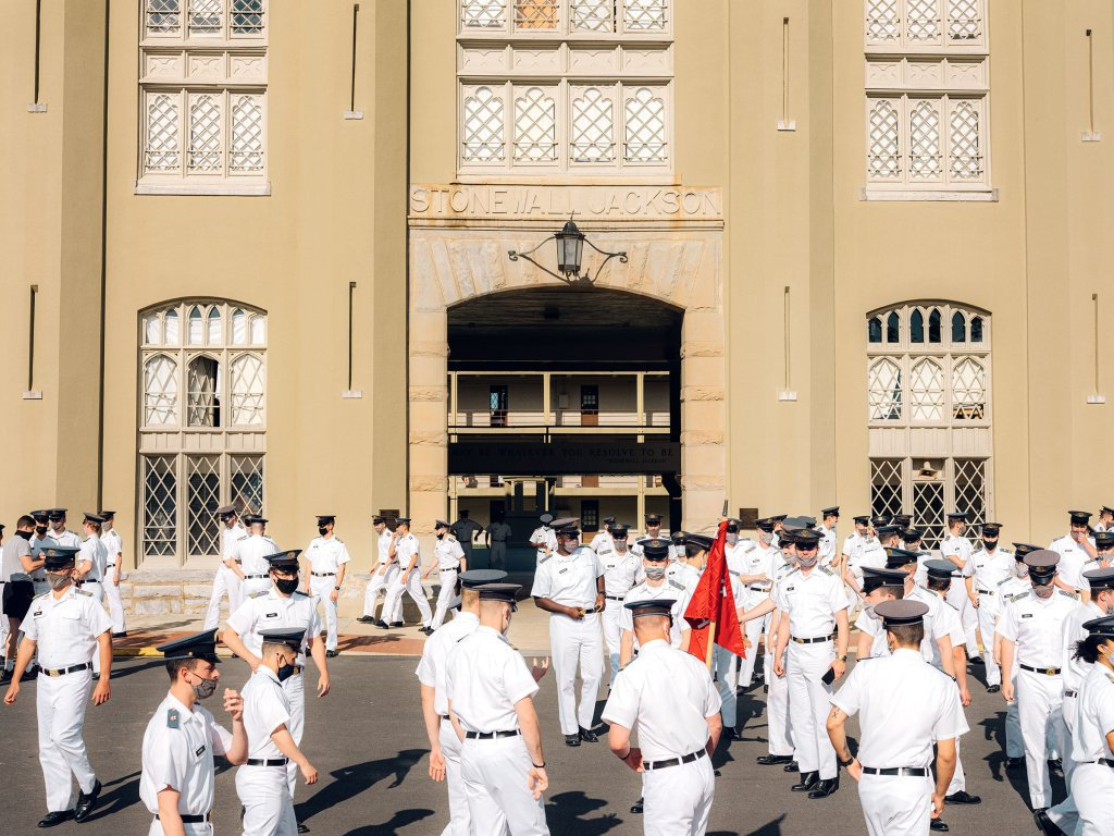Cadets gather outside the stone arch bearing Stonewall Jackson's name.