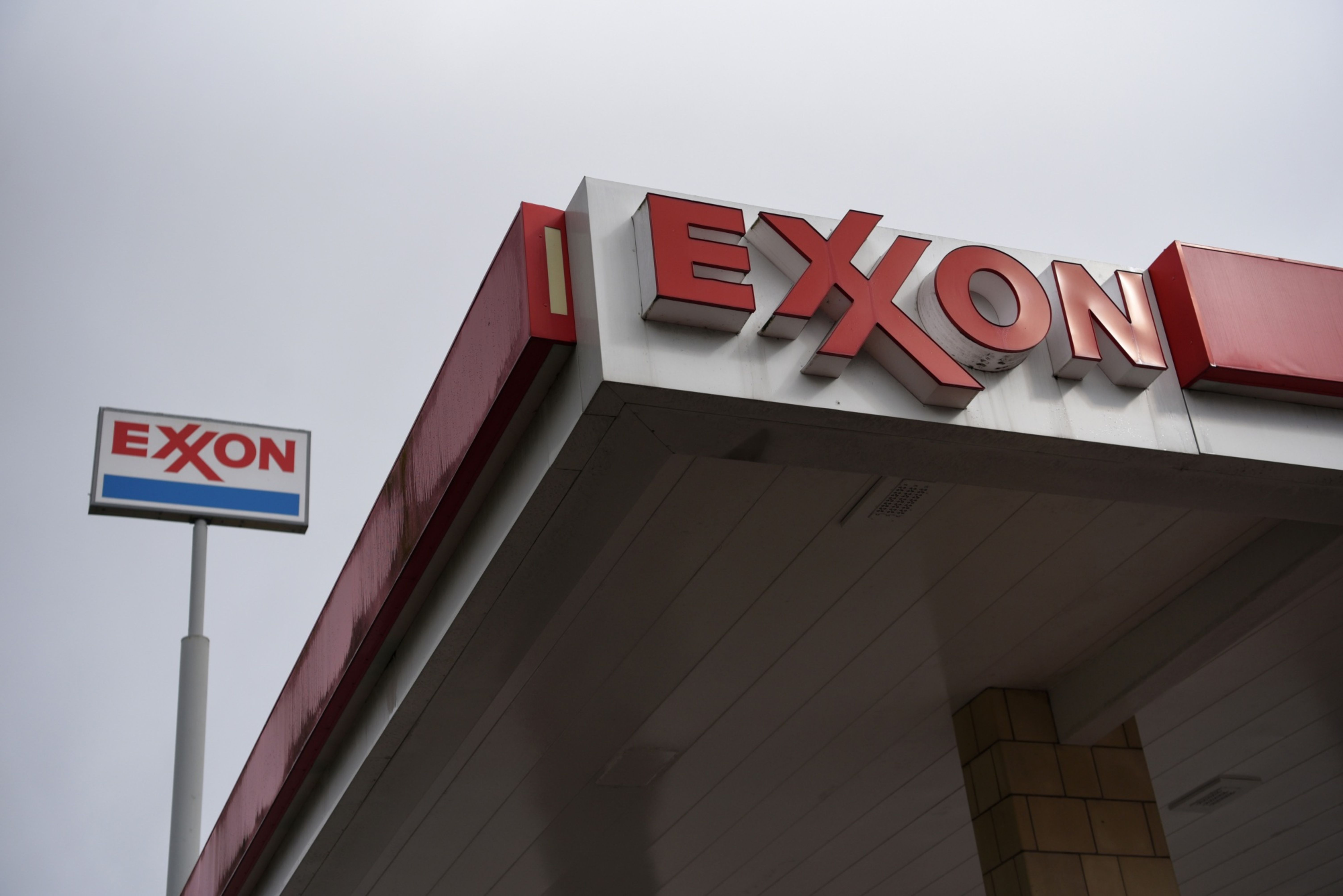 Signage at an Exxon Mobil Corp. gas station in Houston, Texas, U.S., on Wednesday, Oct. 28, 2020. Exxon is scheduled to release earnings figures on October 30.
