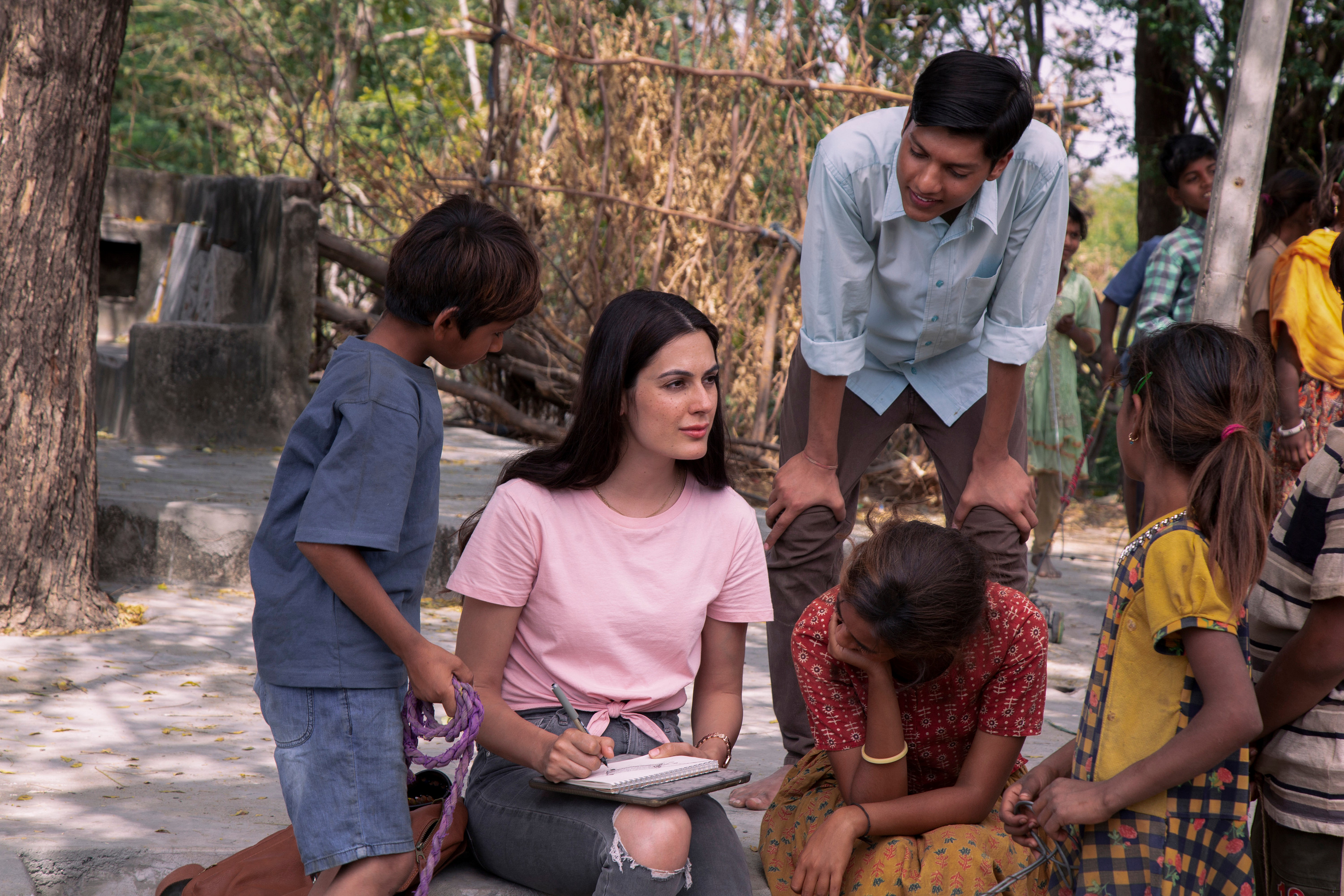 Amy Maghera (center) as visitor Jessica