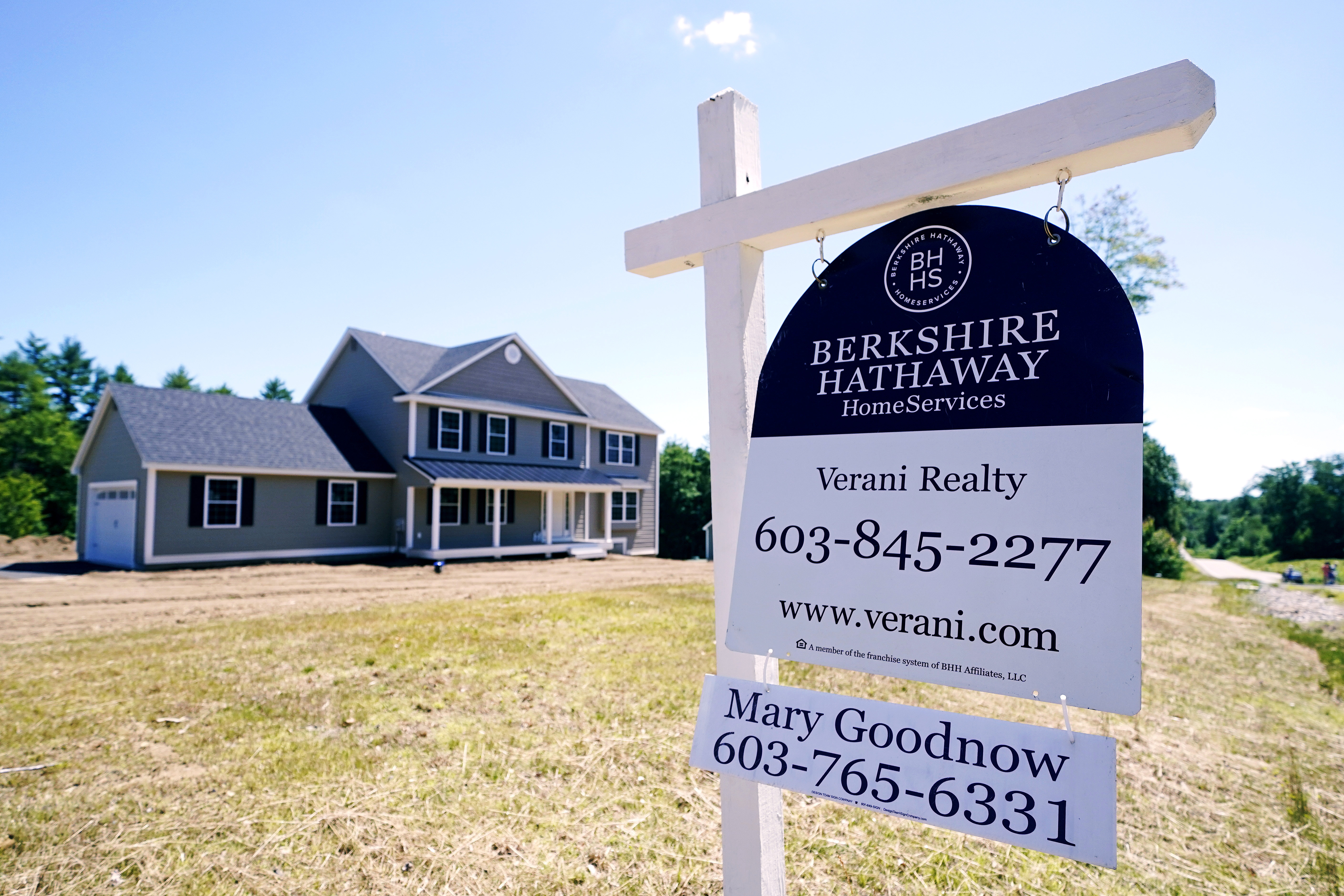 A real estate sign is posted in front of a newly constructed single family home, Thursday, June 24, 2021 in Auburn, N.H.