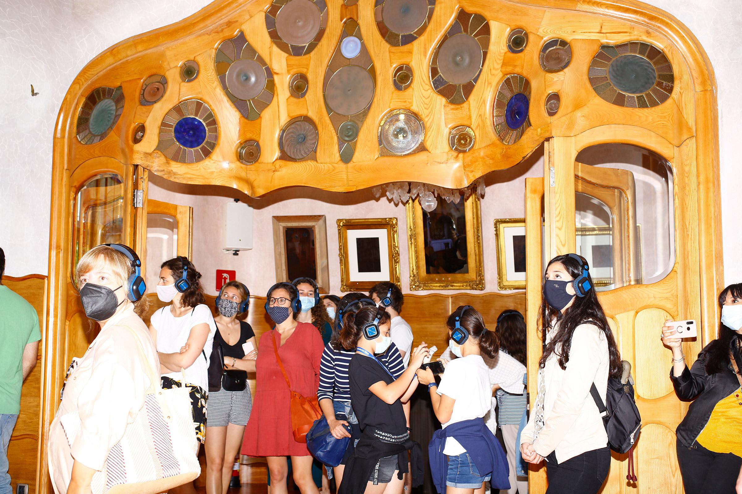 Masked tourists visit Casa Batlló on June 6.