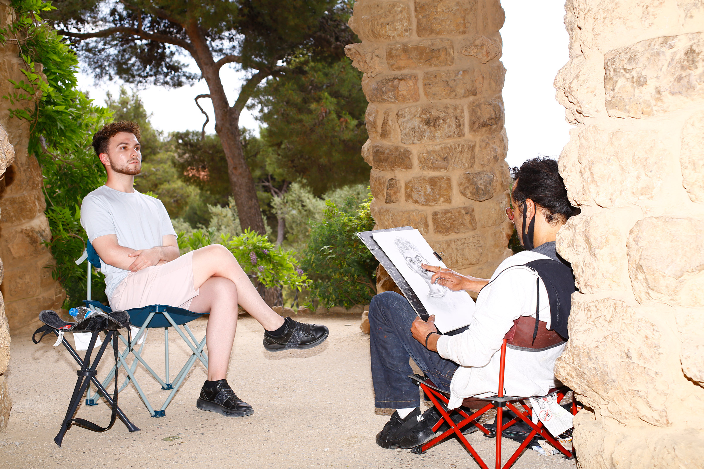 A portrait artist and his subject in Parc Güell on June 6.