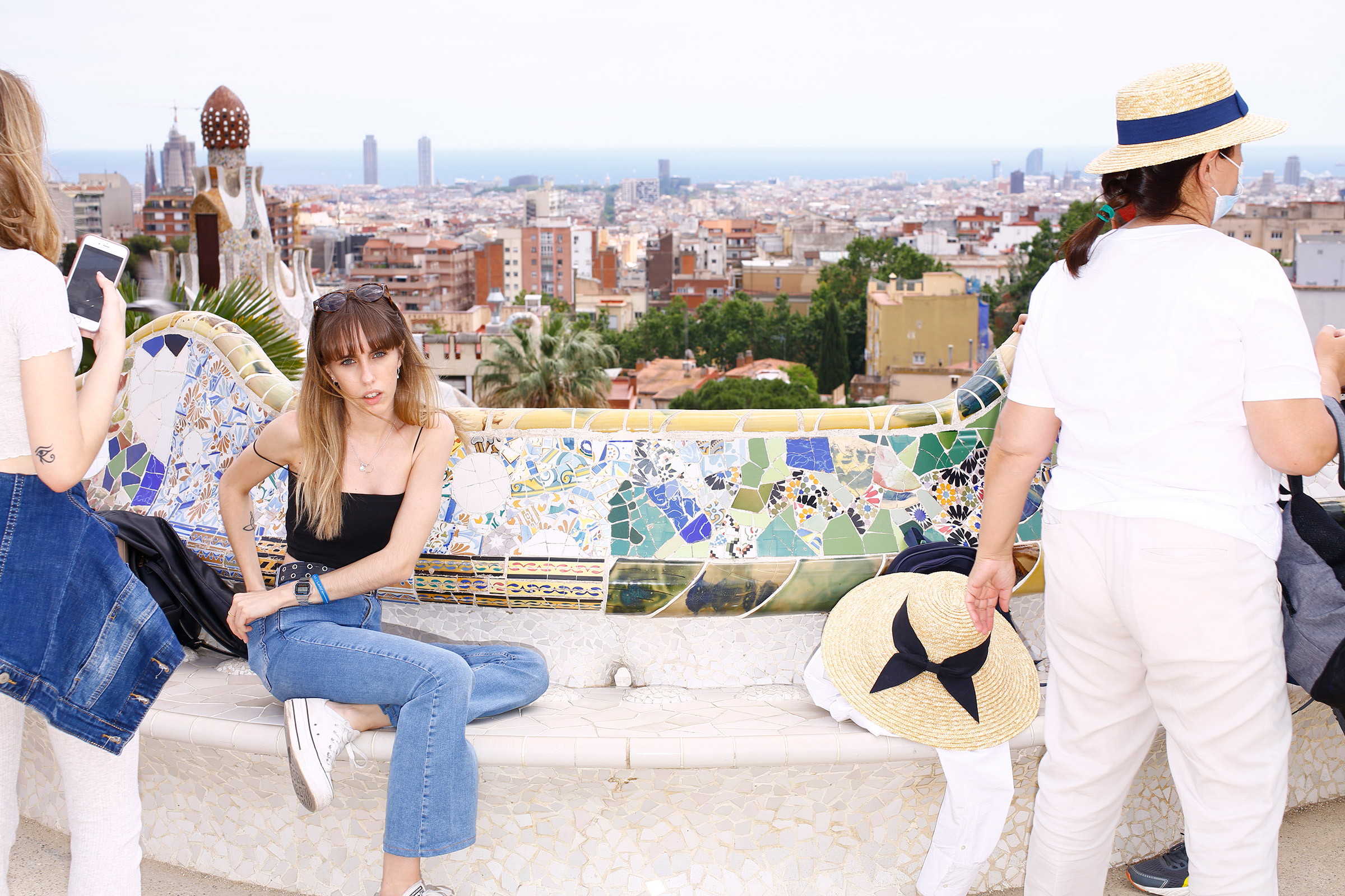 Visitors enjoy the view of the city from Parc Güell on June 6.