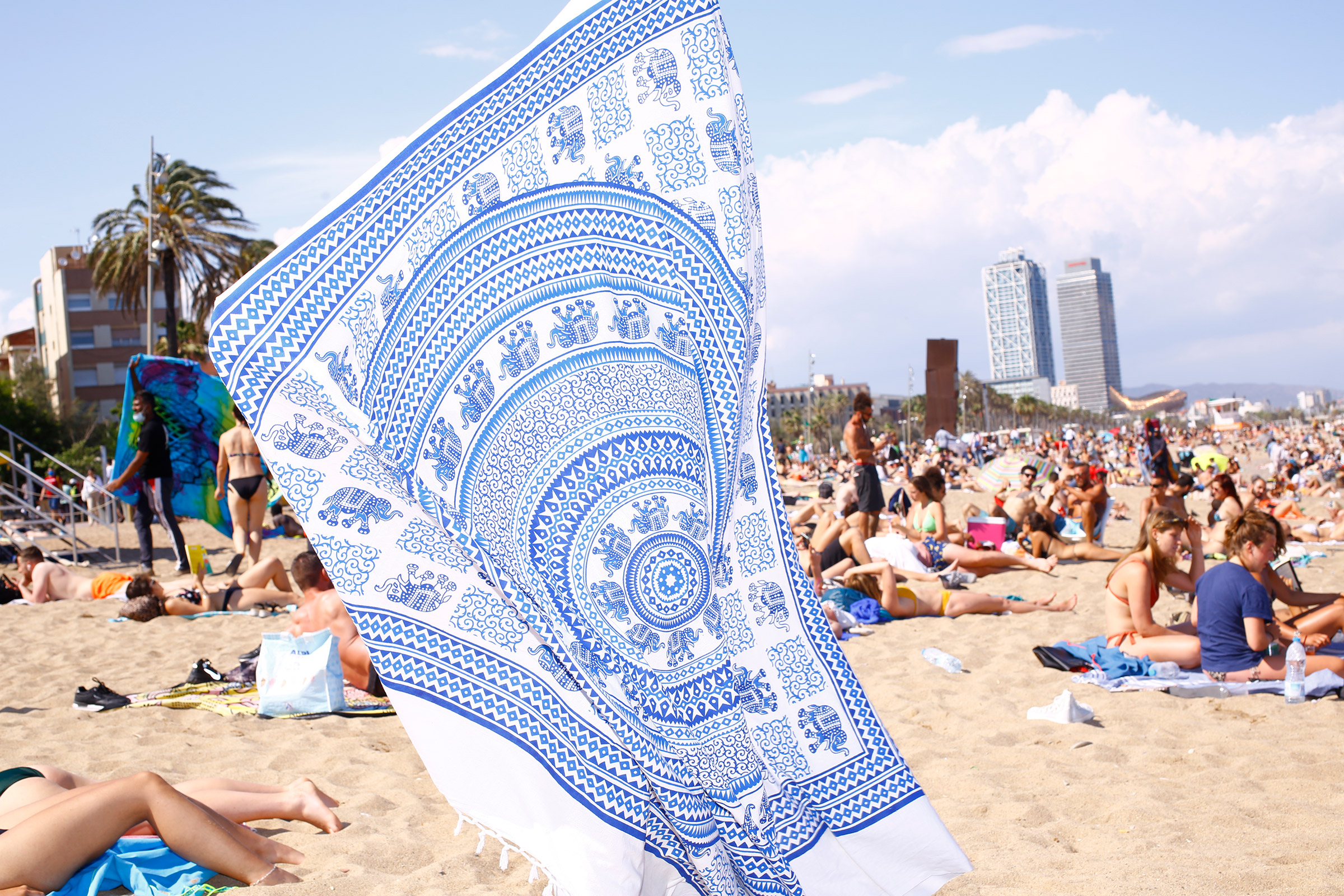 Beach goers find a spot at Barceloneta Beach on June 6.